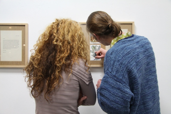 Boris Duhm and Tijana Titin, both featured artists, looking at the piece of BorisPhoto by Alexander Czekalla